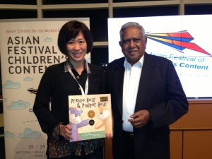 Presenting my book to Mr SR Nathan (6th President of Singapore)after the staging of Prince Bear & Pauper Bear