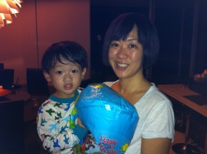 Caleb hugging the balloon that eluded him for 5 days