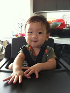 Caleb on highchair 2