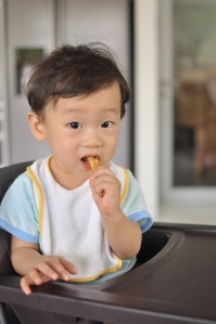 """""""Not sweet, not sour...hmm, what is this?"""" Caleb investigates this strange new food (at under 1 year)"""