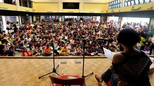 Me leading 200 children in mass reading (Photo: Sunday Times 20 July 2014)