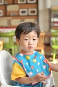 Asian-spiced kid during food tasting