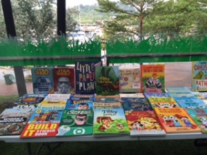 My Tibby & Toy Titles at Closetful of Books' Pop-Up Book Sale at Quayside against backdrop of private yachts as Sentosa Marina